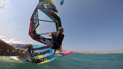 Greek Kiter going off on Greek Windsurfer